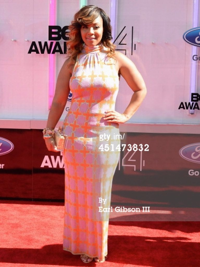 Grammy Award winner Erica Campbell at the BET Awards in Conqueror Gold by Marion Ayonote image